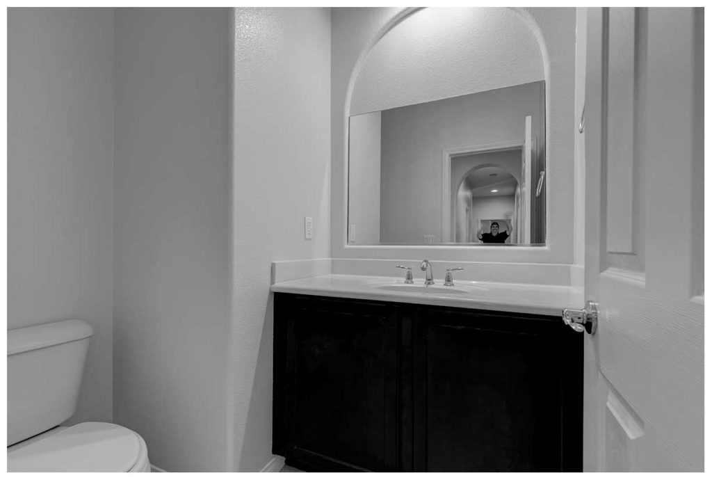 Guy in a mirror. Las Vegas real estate photographer.